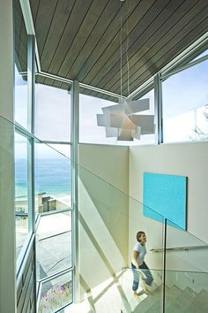 love the Big Bang Chandelier by Foscarini in this space. modern staircase by Horst Architects