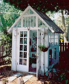A great way of reusing windows and doors as a greenhouse.