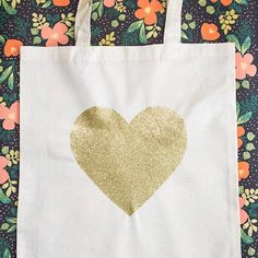 Learn how easy it is to create your own gold glittered heart tote. (Or any other shape you can cut out of a stencil!)
