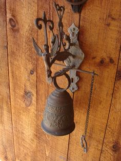 old brass bell with angel
