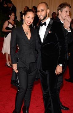 """Alicia Keys and Swizz Beatz attend the Costume Institute's gala for the exhibit """"Schiaparelli and Prada: Impossible Conversations"""" at New York's Metropolitan Museum of Art on May 7, 2012."""