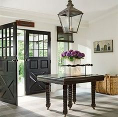 Love the lantern light fixture and the black double doors..