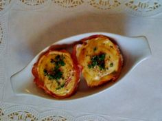 Ham and Egg Pies from Food.com:   Great for breakfast, picnics or just a snack.