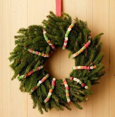 Colorful gumdrops spruce up an evergreen wreath. More wreath ideas: http://www.midwestliving.com/homes/seasonal-decorating/beautiful-holiday-wreaths/?page=16,0