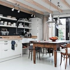 Love this black and white kitchen with farmhouse table!