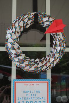 Wreath at a Paper Airplane Birthday Party #paperairplane #partywreath