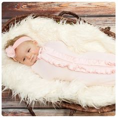 The Woombie is the safest, most natural way to swaddle your baby.