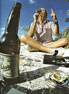 Hunter S. Thompson photographed March 12, 1974 on the beach of Cozumel, Mexico by Al Satterwhite.