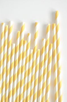 yellow and white stripe straws