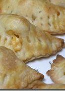 Easy Cheesy Chicken Empanadas #Recipe via AFewShortCuts.com