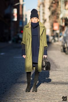 The olive army trench coat over a navy & black outfit.