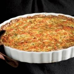 Savory Carrot & Tarragon Tart--The bright orange carrots in this savory tart are a feast for the eyes and the palate. Tarragon lends bold flavor to the tart. Other herbs, such as thyme or rosemary, would be delicious too. #thanksgiving @EatingWell