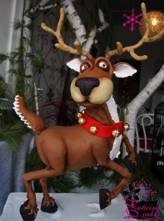 Remy the Reindeer - 3D Vanilla Cake hand dusted fondant and modelling chocolate standing on one leg.