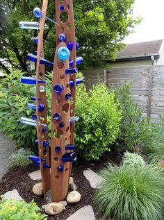 Best funky junky bottle tree I've seen.
