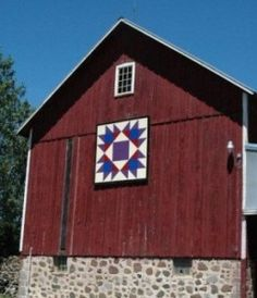 red blue on red barn, American Quilters Society article.