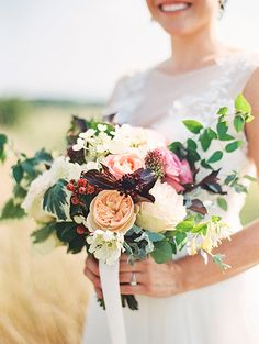 autumn-inspired bouquet featuring roses and berries by Petal & Print