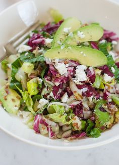 Lunch Recipe:  Radicchio Salad with Avocado, Red Quinoa & Ricotta Salata   Recipes from The Kitchn  #salad #quinoa #garlic #lemon #oliveoil #garlic #honey #romaine #lettuce #radicchio #shallot #almonds #ricotta #avocado #glutenfree
