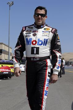 Tony Stewart makes his way down pit road before the start of the SaveMart 350k at Sonoma Raceway. View more photos from Sonoma here: http://www.stewarthaasracing.com/media/gallery/index.php