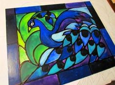 Faux stained glass made from acrylic paint and school glue!  Lots of great tutorials on this site!
