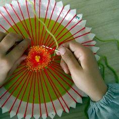 Paper plate weaving.