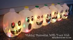 Milk Jug Ghost Row - I would use white or orange lights instead of the multicolored ones.  I might also paint the jugs black all over, and leave white to glow through on the eyes and mouths (using precut stencils to avoid getting the black paint in those places).  I can't wait to do this with my kids for our FAVORITE holiday!
