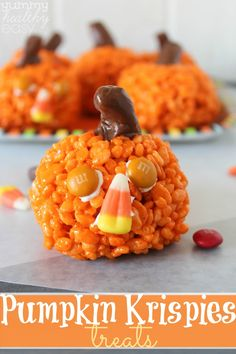 Easy Pumpkin Krispies Treats - cute little pumpkin-shaped rice krispies treats that can be made with candy faces for Halloween or without all the way through to Thanksgiving! Perfect little treat for teachers or friends!