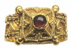 Merovingian Architectural Gold Ring. This shows what Merovingian ring manufacturers could achieve in France in the mid-500s.  This type of rings are usually found in Gaulish tombs of noble womens and is seen as a sign of Christianity due to resemblance to early baptistery. Gauls was Christianized in the 496th