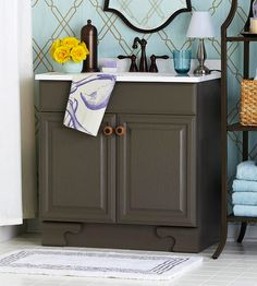 Update a bathroom vanity by painting it a trendy color. See more low-cost bath updates: http://www.bhg.com/bathroom/small/low-cost-updates/#page=15