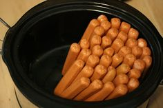 Stand hotdogs on end in a crockpot. There's no need to add water.  The hotdogs will release moisture all on their own.  Cover, and cook on low for 4 hours, or on high for about 2 hours--check to make sure the ones in the middle are fully hot before serving.  dogs remind him of the hot dogs from 7-11 or the movies where they cook on the roller bars. Doing this for Leeland's birthday tomorrow