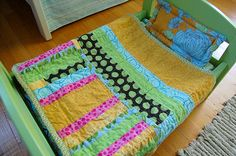 Adorable doll quilt.