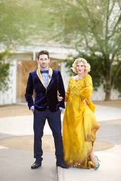 Yellow wedding dress on her, blue velvet jacket on him!