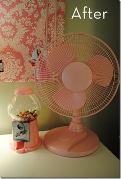 Spray paint a cheap white fan. Bought about 5 of these this summer at garage sales, perfect to paint for the kids room.