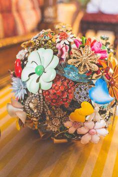 bright brooch bouquet, photo by Heidi Benjamin http://ruffledblog.com/revolution-hall-wedding #weddingbouquet #broochbouquet