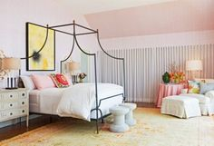 Canopy bed and pale pink walls, this definitely falls on our dream bedroom list.
