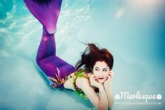 Underwater photograph of mermaid Ondine of the Merlesque mermaid troupe, taking a break at the bottom of a swimming pool. Find out more about the Merlesque professional mermaids at: http://www.realmermaids.co.uk