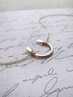 Small gold horseshoe necklace by OliveYewJewels, of Charlotte,   NC $37.00