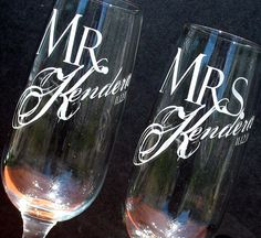 Two Custom Engraved Wedding Champagne Glasses. These would make great keepsakes for the wedding day!
