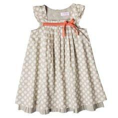 Gray dress with polka dots and pink ribbon.