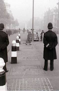 Not a hi-viz jacket in sight. Parliament Street and Whitehall, London, probably 8 November 1959 by allhails, via Flickr.