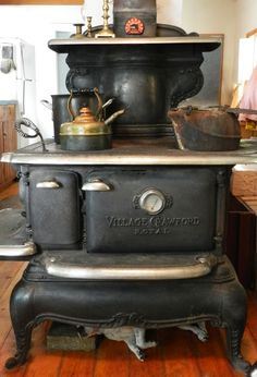 wood burning stove - the one thing my Mom asked my Dad to include in our home. She always wanted a black, woodburning stove in the kitchen. This is fancier than the one we had. Boy, did it come in handy in harsh Maine winters!!