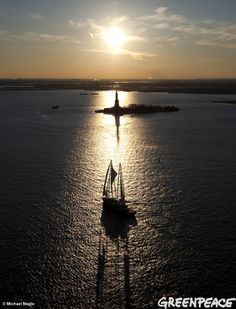 Greenpeace February 2012 Photo of the Month - The Rainbow Warrior sails by the Statue of Liberty in New York Harbor