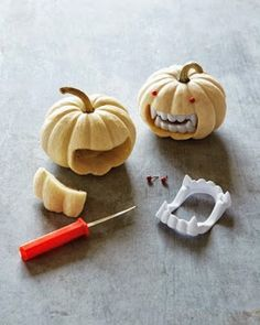 "Need to add some flair to your Halloween pumpkin this year?  Try adding some teeth to your jack-o'-lantern!  -Get some halloween vampire fangs. -Carefully cut a square out of the ""mouth"" of your pumpkin...just a little wider than the width of the teeth. -Plug in the fangs. -You can add a few pushpins for beady eyes!  Now, go scare someone!"