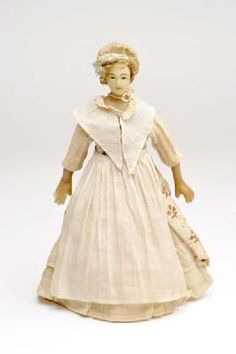 Doll from the Blackett 'baby house', 1760-1780, dressed in typical clothes of a domestic servant in this period.