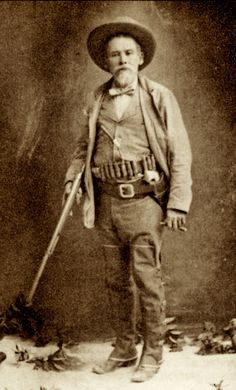 TEXAS JOHN SLAUGHTER — How fitting that the 1887 Winchester pump shotgun was created the same year that Texas John Slaughter became Cochise County sheriff. He handsomely wields that scattergun in this photograph, while he also packs his pearl-handled Colt Peacemaker. His Arizona peers called him Texas John because of his years working as a Texas Ranger.
