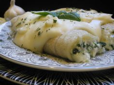 Three Cheese Spinach Manicotti with Creamy Caramelized Garlic Sauce