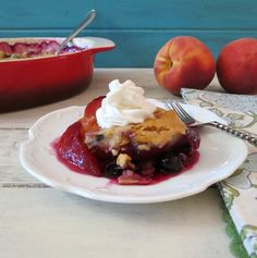 Lightened Up Peach and Blueberry Cobbler - A sweet, low calorie fruit dessert made with fresh peaches and blueberries, covered by a whole wheat bread topping.