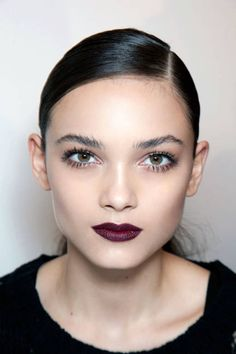 Bold brows, lashes and deep red lip