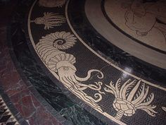 Reconstruction of an ammonite by mosaicist Hildreth Meiere (in the Nebraska State Capitol). state capitol, fossil decor, art tile, hildreth meier, nebraska state