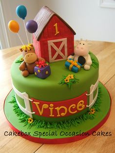 Farm cake with fondant modeled animals, balloons and barn.  Barn is Rice Krispie Treats covered with fondant.