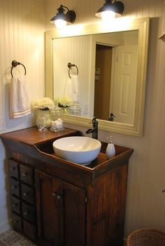 What a cool bathroom vanity. Its a great way to re-purpose an antique dry sink and add a modern feel with the vessel sink and faucet.
